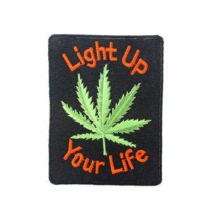 Patch Light Up Your Life อาร์มติดเสื้อปักลาย ใบกัญชาสีเขียวบนพื้นหลังสีดำ